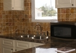 Laminate Kitchen with Stone Backsplash