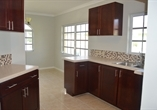 Wooden Cabinets with Corian Tops
